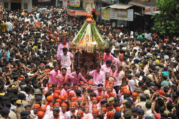 Devotees throng around a chariot bearing