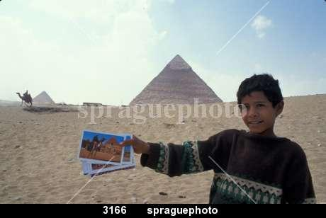 3166-Boy-selling-postcards-at-the-pyramids-of-Giza,-Egypt.-6939
