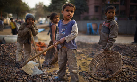 Indian children working parents at a construction site near the Jawaharlal Nehru Stadium, Delhi