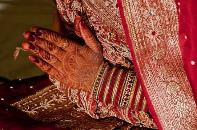 10689078-indian-wedding-bride-getting-henna-applied-marriage-engagement