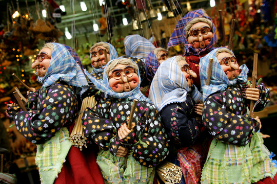 Epiphany puppets are sold at the traditional Christmas market in Rome's Navona square