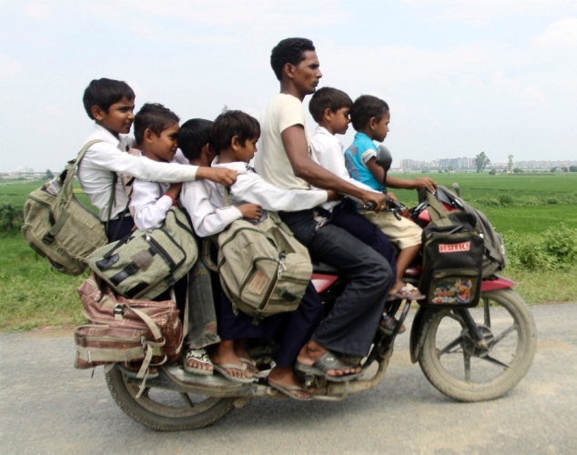 Image result for indian guy on scooter