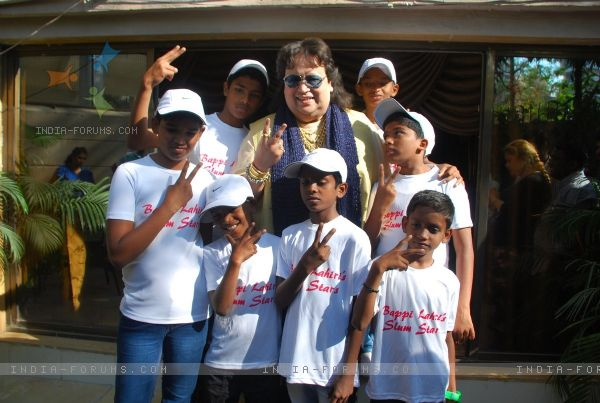 Bappi Lahiri poses with Slum Kids