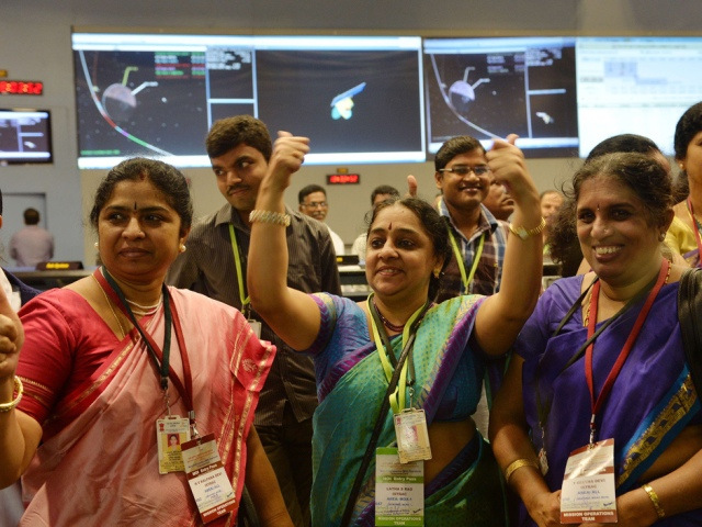 "Indian staff from the Indian Space Research Organisation (ISRO) celebrate after the Mars Orbiter Spacecraft (MoM) successfully entered the Mars orbit at the ISRO Telemetry, Tracking and Command Network (ISTRAC) in Bangalore on September 24, 2014. India became the first nation to reach Mars on its maiden attempt September 24 when its low-cost Mangalyaan spacecraft successfully entered orbit around the Red Planet after a 10-month journey. ""India has successfully reached Mars... History has been created today,"" a jubilant Prime Minister Narendra Modi said from mission control after entry into orbit was confirmed at 8:02am (0232 GMT). AFP PHOTO/Manjunath KIRANManjunath Kiran/AFP/Getty Images"