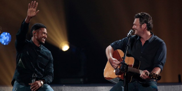 This image released by NBC Universal shows country singer Blake Shelton, right, and Usher during the Healing in the Heartland: Relief Benefit Concert at the Chesapeake Energy Arena in Oklahoma City, Okla., Wednesday, May 29,2013. Funds raised by the benefit will go to the United Way of Central Oklahoma, for recovery efforts for those affected by the May 20 tornado. (AP Photo/NBC, Brett Deering)